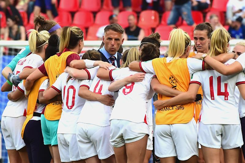 VALENCIENNES, FRANCE - JUNE 23: (C) England coach Phil Neville celebrate with his players at the end of the 2019 FIFA Women's World Cup France Round Of 16 match between England and Cameroon at Stade du Hainaut on June 23, 2019 in Valenciennes, France. (Photo by Pier Marco Tacca/Getty Images)