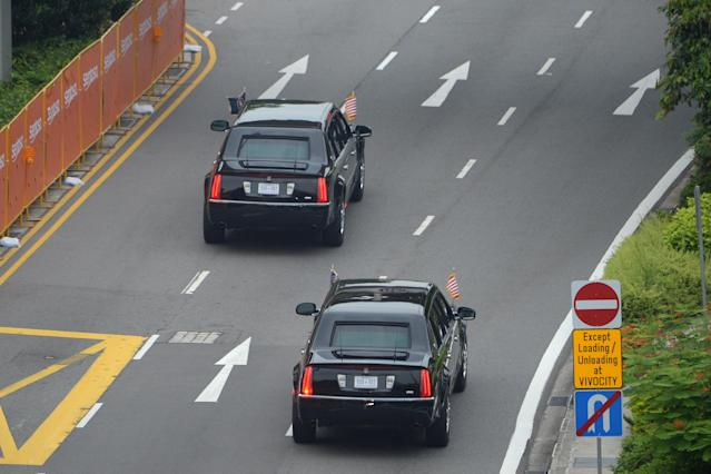 <p>The motorcade carrying US President Donald Trump sets off to Sentosa, the resort island where Trump is scheduled to meet with North Korea's leader Kim Jong Un for a US-North Korea summit, in Singapore on June 12, 2018. – Donald Trump and Kim Jong Un will make history on June 12, becoming the first sitting US and North Korean leaders to meet, shake hands and negotiate to end a decades-old nuclear stand-off. (Photo: Ted Aljibe/AFP/Getty Images) </p>
