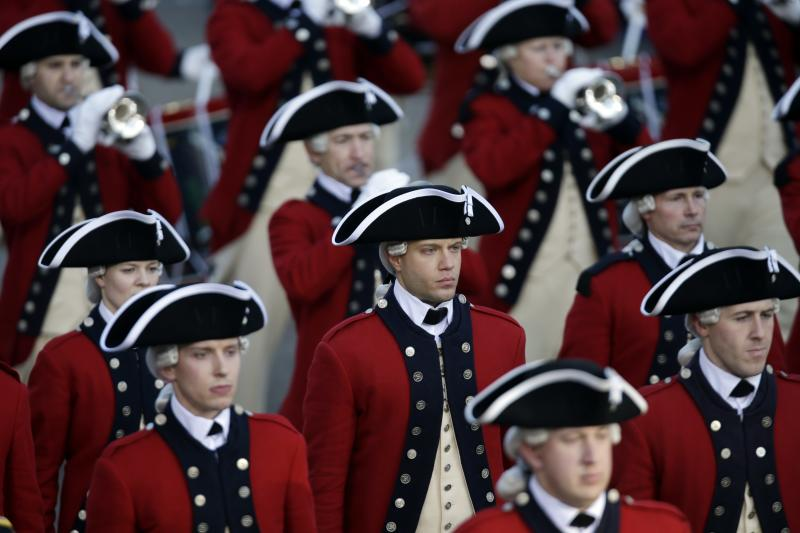 The Army's Old Guard Fife and Drum Corps walks down Pennsylvania Avenue en route to the White House, Monday, Jan. 21, 2013, in Washington. Thousands  marched during the 57th Presidential Inauguration parade after the ceremonial swearing-in of President Barack Obama. (AP Photo/Charlie Neibergall)