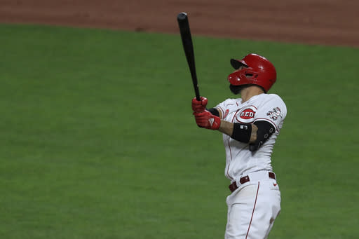 Cincinnati Reds' Nicholas Castellanos watches as he hits a three-run home run in the seventh inning during a baseball game against the Pittsburgh Pirates in Cincinnati, Friday, Aug. 14, 2020. (AP Photo/Aaron Doster)