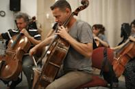 """The Israel Camerata Jerusalem Orchestra play instruments from the """"Violins of Hope"""" project during a rehearsal"""