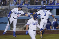 Los Angeles Dodgers' Chris Taylor, right, celebrates with A.J. Pollock after hitting a home run during the fourth inning of the team's baseball game against the Oakland Athletics on Tuesday, Sept. 22, 2020, in Los Angeles. (AP Photo/Ashley Landis)