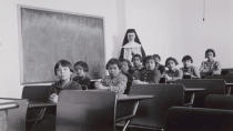 A group of female students and a nun pose in a classroom at Cross Lake Indian Residential School in Cross Lake, Manitoba in a February 1940 archive photo. REUTERS/Canada. Dept. Indian and Northern Affairs/Library and Archives Canada/e011080274/handout
