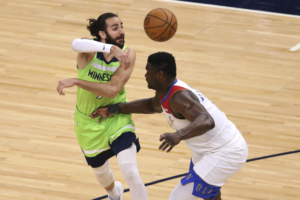 Minnesota Timberwolves' Ricky Rubio (9) passes the ball over New Orleans Pelicans' Zion Williamson during the second half of an NBA basketball game Saturday, May 1, 2021, in Minneapolis. (AP Photo/Stacy Bengs)