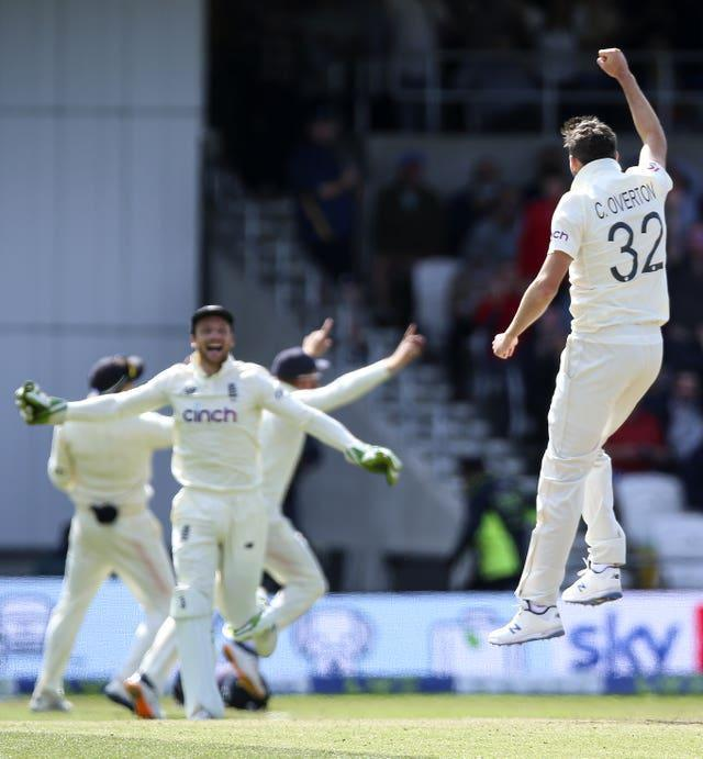 England's Craig Overton (right) celebrates after taking the wicket of India's Mohammed Siraj to win the third Test at Headingley