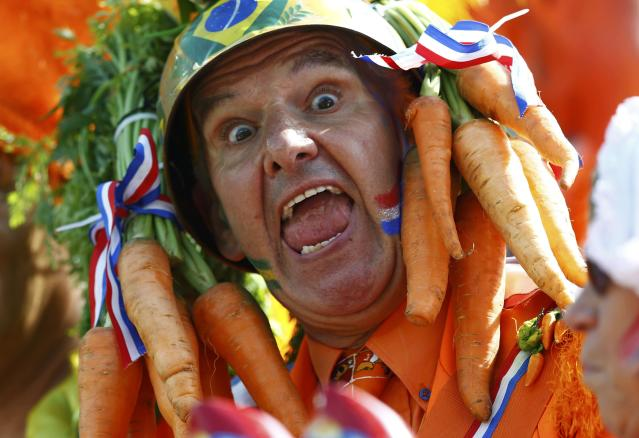 A fan of the Netherlands cheers before their 2014 World Cup Group B soccer match against Chile at the Corinthians arena in Sao Paulo June 23, 2014. REUTERS/Ivan Alvarado (BRAZIL - Tags: SOCCER SPORT WORLD CUP)