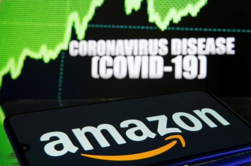 FILE PHOTO: Amazon logo is seen in front of diplayed coronavirus disease (COVID-19)