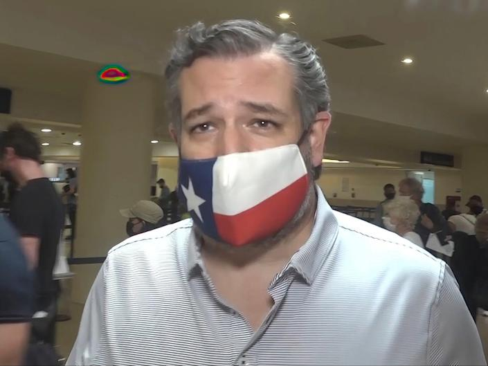 In this image from video, Sen. Ted Cruz, walks to check in for his flight back to the US, at Cancun International Airport in Cancun, Mexico, on Thursday 18 February 2021 ((Associated Press))