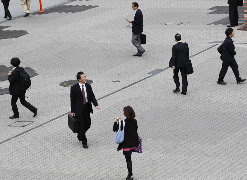 People walk around Shinbashi train station in Tokyo Tuesday, May 31,  2011. Japan's unemployment rate in April rose for the first time in six months, while the nation's industrial production rebounded weakly from a record drop following March's earthquake and tsunami. (AP Photo/Koji Sasahara)