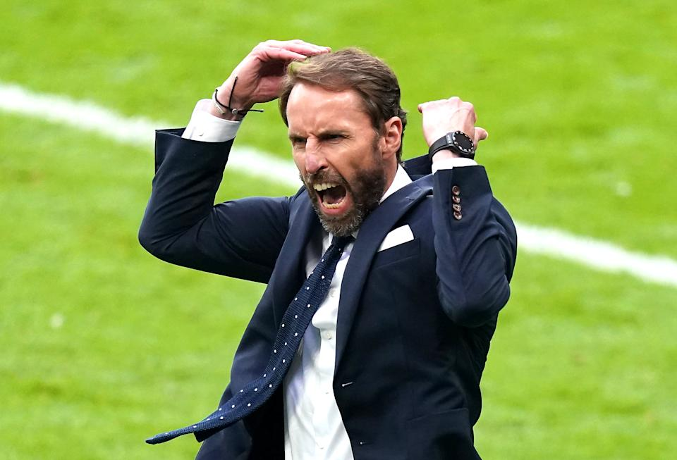 England manager Gareth Southgate celebrates his side's second goal of the game, scored by Harry Kane during the UEFA Euro 2020 round of 16 match at Wembley Stadium, London. Picture date: Tuesday June 29, 2021.