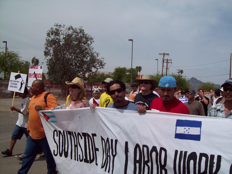 Rev. Alison Harrington (left, in pink) demonstrating with members with members of the Southside Worker Center against Arizona's anti-immigrant bill SB1070 in 2010. (Southside Presbyterian Church)