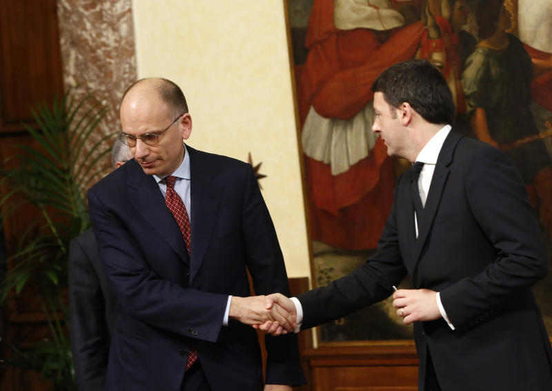 Italian outgoing Premier Enrico Letta, left, shakes hands with new Premier Matteo Renzi as he leaves after handing him over the cabinet minister bell during the handover ceremony at Chigi Palace Premier's office, in Rome, Saturday, Feb. 22, 2014. Renzi has been sworn in as Italy's youngest premier, heading a new government he says promises will swiftly tackle old problems. Renzi had been serving as Florence mayor when he engineered a power grab last week to effectively force fellow Democrat, Enrico Letta, to step down after 10 months at the helm of a fragile, often-squabbling coalition. (AP Photo/Riccardo De Luca)