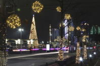 A square decorated for New Year celebrations is seen nearly deserted and without the Holiday Market due to the virus-related restrictions prior to New Year's celebrations in Grozny, Russia, Thursday, Dec. 31, 2020. (AP Photo/Musa Sadulayev)