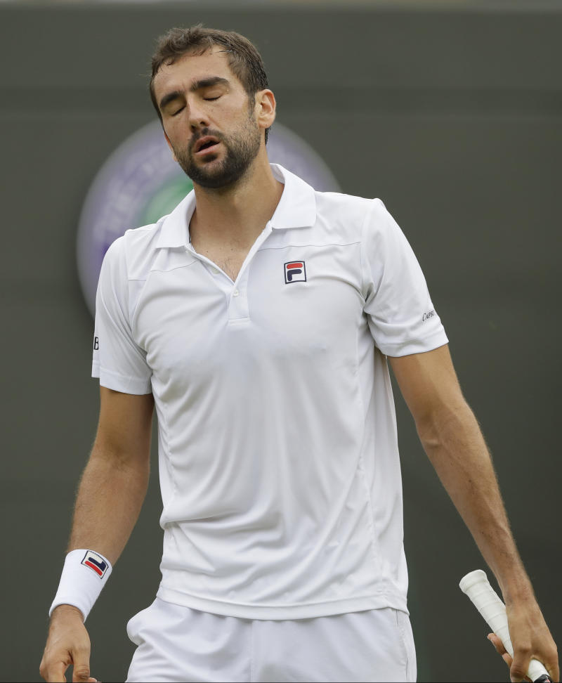 Cilic and defending champ Muguruza stunned at Wimbledon