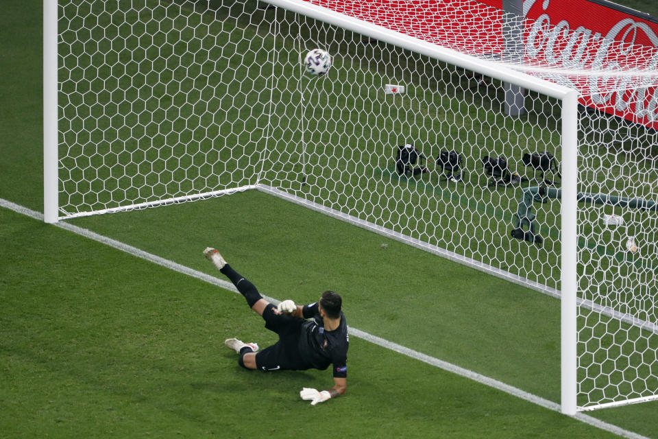 Portugal's goalkeeper Rui Patricio (1) looks back as a penalty kick by France's Karim Benzema goes into the net for a goal the Euro 2020 soccer championship group F match between Portugal and France at the Ferenc Puskas stadium in Budapest, Hungary, Wednesday, June 23, 2021. (AP Photo/Laszlo Balogh, Pool)