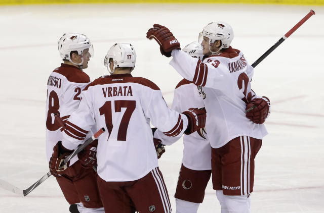 Phoenix Coyotes defenseman Oliver Ekman-Larsson, with arm raised, of Sweden, celebrates his goal with teammates during the second period of an NHL hockey game against the Florida Panthers, Tuesday, March 11, 2014, in Sunrise, Fla. (AP Photo/Wilfredo Lee)