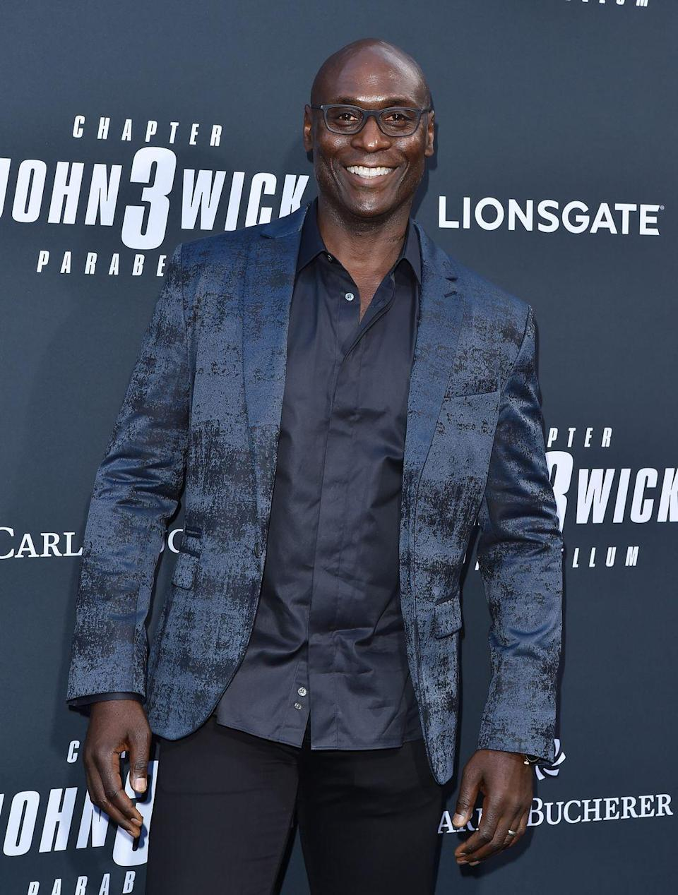 """<p>Following his success, Reddick appeared in <em>Lost</em>, <em>Fringe</em>, <em>American Horror Story</em>, and <em>Bosch</em>. He'll appear next in the upcoming <em>Angel Has Fallen</em> with Gerard Butler and <em>Godzilla vs. Kong</em>. </p><p>He's also appeared on the big screen work in the <em>John Wick </em>franchise as the titular hero's loyal hotel manager, Charon, which he told <em><a href=""""https://www.slashfilm.com/lance-reddick-interview-john-wick-chapter-3-parabellum/"""" rel=""""nofollow noopener"""" target=""""_blank"""" data-ylk=""""slk:SlashFilm"""" class=""""link rapid-noclick-resp"""">SlashFilm</a> </em>gave him a chance to flex his action muscles<em>:</em> """"I love doing action and it's so funny because I've played so many cops, and I rarely get to shoot guns and fight people. <em>Fringe</em>, <em>Bosch</em>, <em>The Wire</em>…""""</p>"""