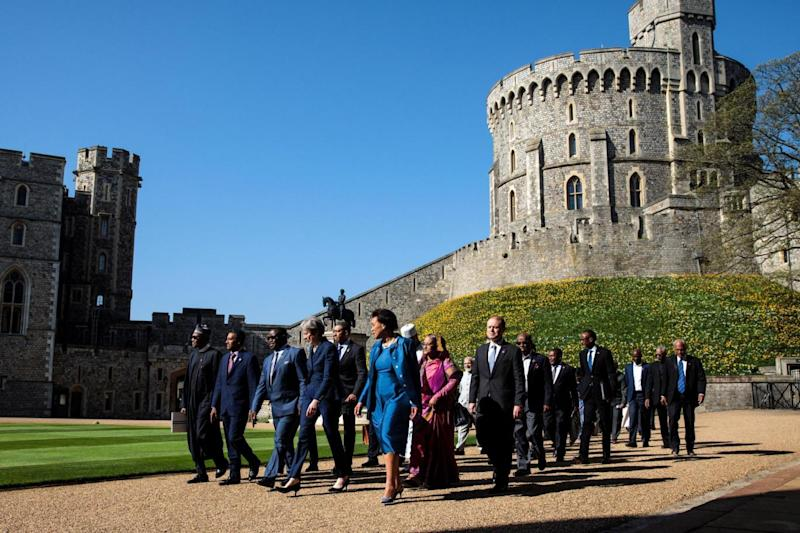 Meeting: Theresa May (centre left) walks with commonwealth leaders at Windsor Castle (PA)