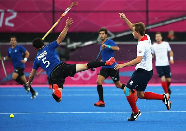 Matt Daly of Great Britain collides with Pedro Ibarra of Argentina during the Men's Hockey Match between Great Britain and Argentina on Day 3 of the London 2012 Olympic Games at the Riverbank Arena on July 30, 2012 in London, England. (Photo by Daniel Berehulak/Getty Images)