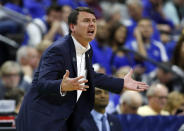 Abilene Christian coach Joe Golding shouts during the first half against Kentucky in a first-round game in the NCAA mens college basketball tournament in Jacksonville, Fla., Thursday, March 21, 2019. (AP Photo/Stephen B. Morton)
