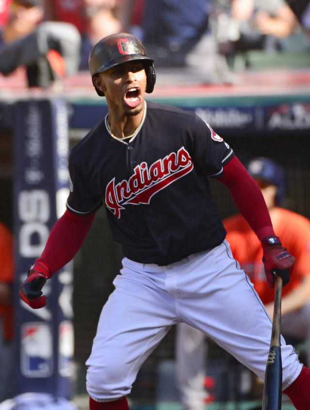 Cleveland Indians' Francisco Lindor watches his ball after hitting solo home run in the fifth inning during Game 3 of baseball's American League Division Series against the Houston Astros, Monday, Oct. 8, 2018, in Cleveland. (AP Photo/Phil Long)