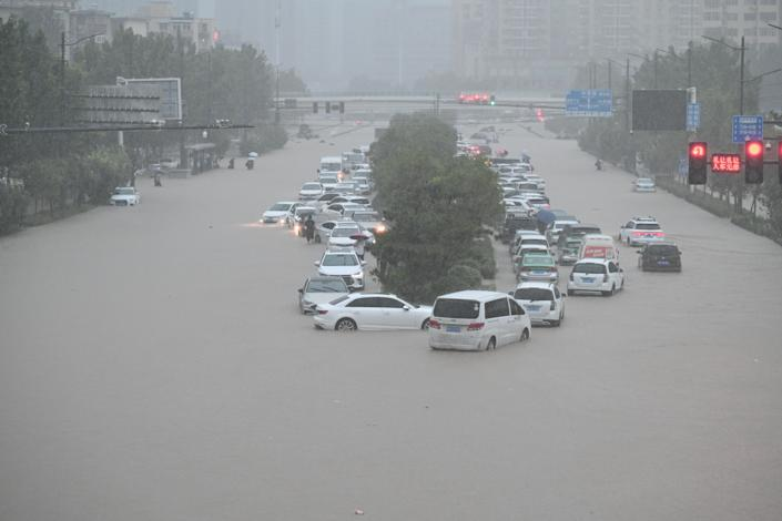 Vehicles are stranded in floodwater near Zhengzhou Railway Station, July 20, 2021.