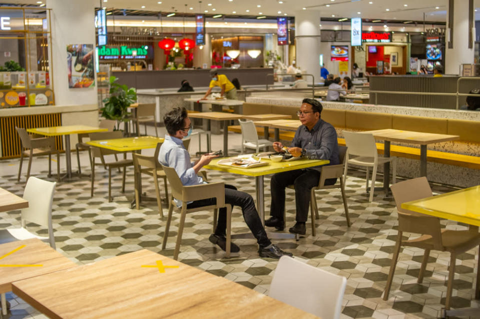 Patrons are seen here having their meals at Pavilion KL during lunch hour. — Picture by Shafwan Zaidon