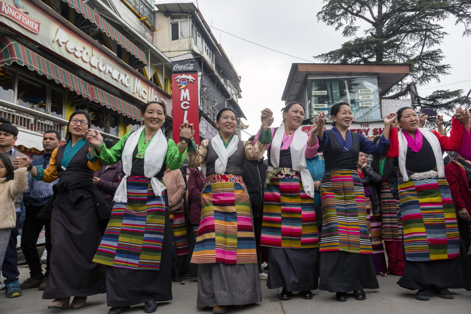 Exile Tibetans perform a traditional communal dance in the town square to celebrate the third day of the Tibetan New Year or Losar in Dharmsala, India, Wednesday, Feb. 26, 2020. (AP Photo/Ashwini Bhatia)