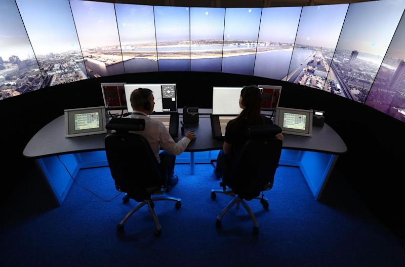 NATS personnel give a demonstration in the operations room at National Air Traffic Services (PA)
