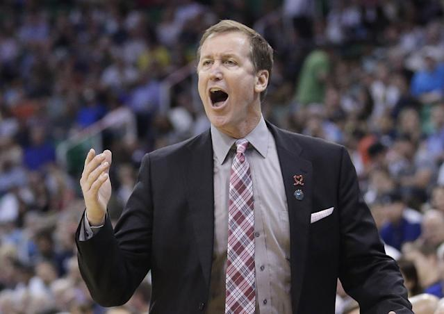Portland Trail Blazers' head coach Terry Stotts shouts with his team in the second half during an NBA basketball game against the Utah Jazz Friday, April 11, 2014, in Salt Lake City. The Trail Blazers won 111-99. (AP Photo/Rick Bowmer)