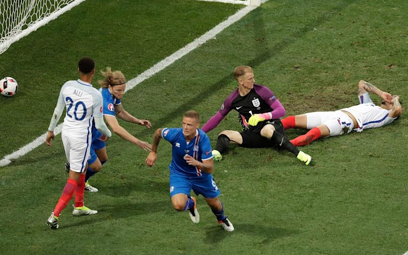 Iceland's Ragnar Sigurdsson, center, celebrates after scoring during the Euro 2016 round of 16 soccer match between England and Iceland, at the Allianz Riviera stadium in Nice, France, Monday, June 27, 2016 - Credit: Ariel Schalit/AP