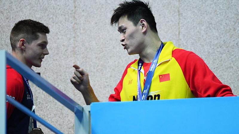 Sun Yang, pictured here clashing with Duncan Scott at the world championships. (Photo by Quinn Rooney/Getty Images)