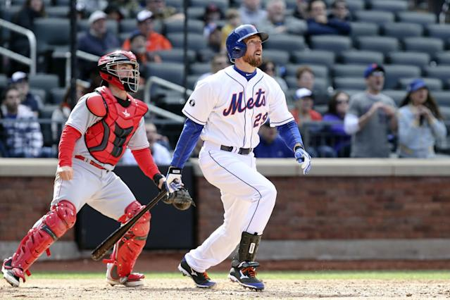 New York Mets first baseman Ike Davis (29) hits a walk-off grand slam in the ninth inning of a baseball game against the Cincinnati Reds at Citi Field, Saturday, April 5, 2014, in New York. The Mets won 6-3. (AP Photo/John Minchillo)