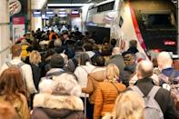 Parisians pack into crowded trains to get out of the French capital before a new month-long partial lockdown begins
