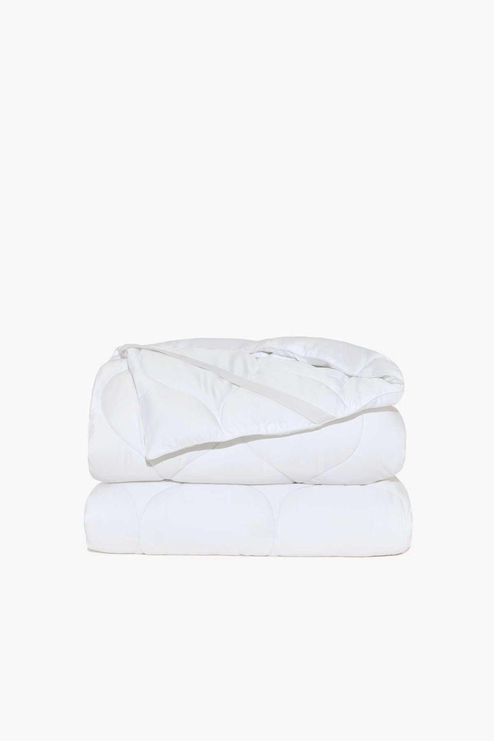 """<h2>Buffy Plushy Mattress Protector</h2><br>Buffy's mattress topper/protector is made from a combination of soft eucalyptus and fluffy recycled fill. The fill keeps plastic bottles out of landfills and protects the geese. Win-win, if you ask us. <br><br><strong>Eco-Sleepers Say:</strong> """"This mattress protector provides a cloud-like layer between you and your mattress. Not only does it make your bed softer and cozier, but it also helps you sleep cooler. We purchased ours after falling in love with the Buffy comforter. I highly recommend that you snuggle down too!"""" <br>— <em>Julie G., Buffy reviewer</em><br><em><br>Shop <strong><a href=""""https://buffy.co/product-listing/all"""" rel=""""nofollow noopener"""" target=""""_blank"""" data-ylk=""""slk:Buffy"""" class=""""link rapid-noclick-resp"""">Buffy</a></strong></em> <br><br><strong>Buffy</strong> Plushy Mattress Protector, $, available at <a href=""""https://go.skimresources.com/?id=30283X879131&url=https%3A%2F%2Fbuffy.co%2Fproducts%2Fmattress-protector%3Fsize%3DQueen"""" rel=""""nofollow noopener"""" target=""""_blank"""" data-ylk=""""slk:Buffy"""" class=""""link rapid-noclick-resp"""">Buffy</a>"""
