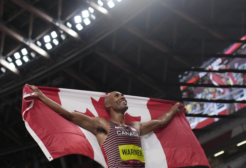Damian Warner, of Canada celebrates after winning the gold medal in the decathlon at the 2020 Summer Olympics, Thursday, Aug. 5, 2021, in Tokyo, Japan. (AP Photo/Francisco Seco)