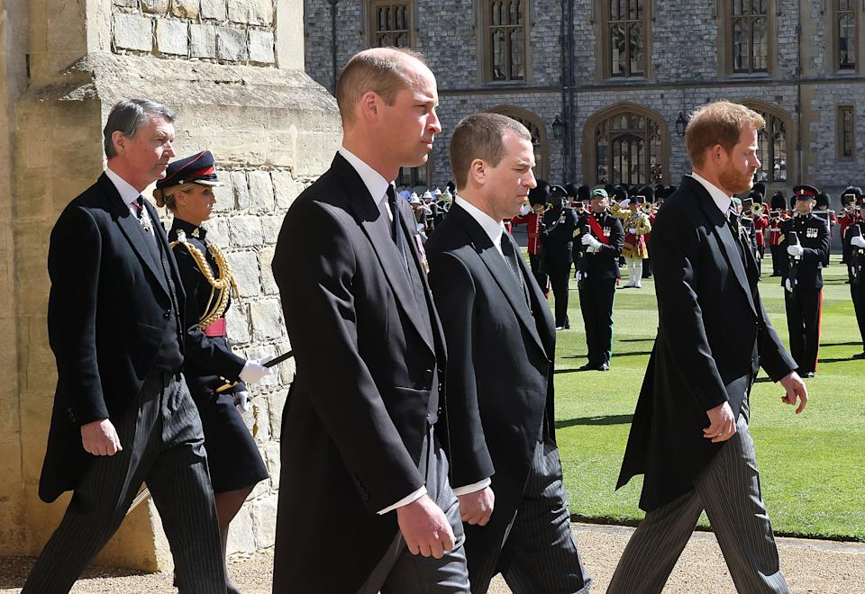 WINDSOR, ENGLAND - APRIL 17: Lieutenant Sir Timothy Laurence, Prince William, Duke of Cambridge, Peter Phillips, Prince Harry, Duke of Sussex following Prince Philip, the Duke of Edinburgh's coffin during the Ceremonial Procession during Prince Philip's funeral , Duke of Edinburgh at Windsor Castle on April 17, 2021 in Windsor, England.  Prince Philip was born in Greece and Denmark 10 June 1921, in Greece.  He served in the British Royal Navy and fought in World War II.  Princess Elizabeth was married at the time on 20 November 1947 and was created Duke of Edinburgh, Earl of Merioneth, and Baron of Greenwich by King VI.  He served as Prince Consort to Queen Elizabeth II until his death on April 9 2021, months short of his 100th birthday.  His funeral is being held today at Windsor Castle with only 30 guests invited due to the constraints of the Coronavirus pandemic.  (Photo by Chris Jackson / Getty Images)