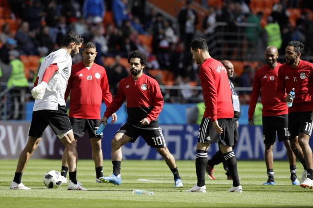Egypt's Mohamed Salah, 3rd left, warms up with team mates ahead the group A match between Egypt and Uruguay at the 2018 soccer World Cup in the Yekaterinburg Arena in Yekaterinburg, Russia, Friday, June 15, 2018. (AP Photo/Mark Baker)