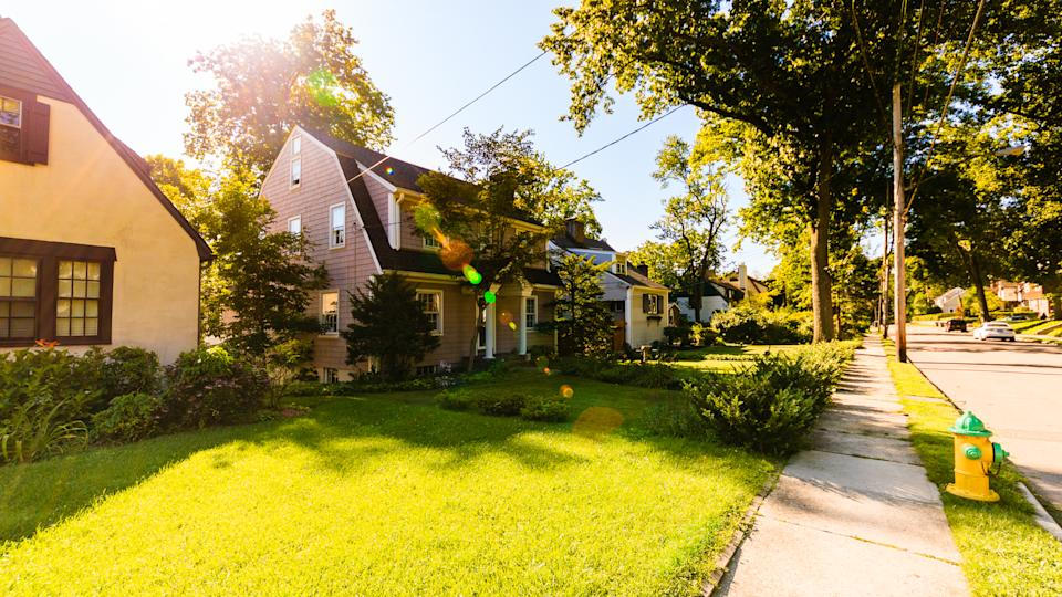 Residential street and living houses in New Rochelle, Westchester, at beautiful sunny day.