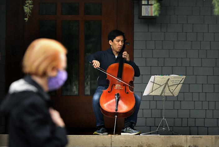 "Beong-Soo Kim, cello; Bonnie Wongtrakool, piano Cellist Beong-Soo Kim and his pianist-wife, Bonnie Wongtrakool, began playing impromptu concerts on their porch in March as a way to give back to their Pasadena community. The neighborhood soon caught on, and the couple's weekly concerts became a joyous, much-anticipated happening. ""We thought with so much suffering, and so much anxiety, this is something very small that we can try to do to help,"" Kim says. <span class=""copyright"">(Christina House/Los Angeles Times)</span>"