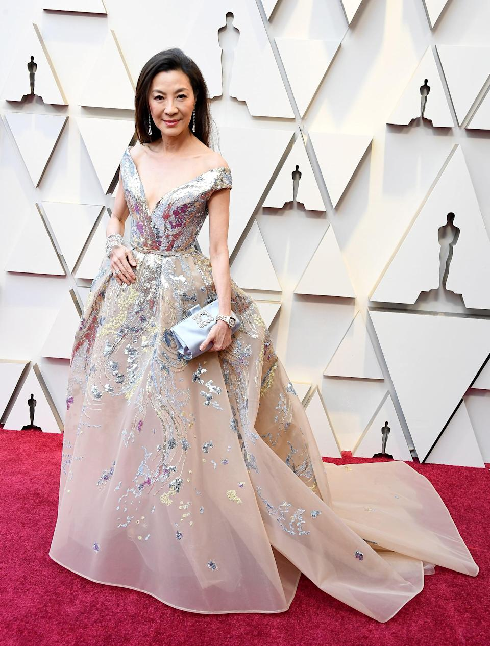 <p>Wearing an Elie Saab dress with Chopard jewels and a Roger Vivier clutch.</p>