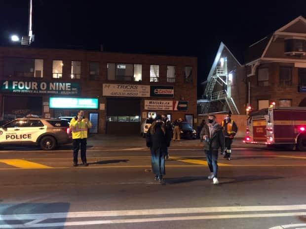 Residents were evacuated from their building on Bloor Street West early Wednesday morning after a resident's carbon monoxide detector went off. After multiple city and fire crew investigations, the residents were told they had 24 hours to vacate their units. (Miles Gertler - image credit)