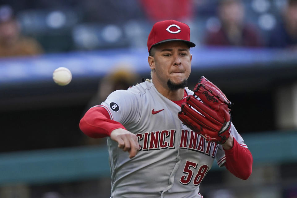 Cincinnati Reds starting pitcher Luis Castillo throws out Cleveland Indians' Austin Hedges at first base after a bunt during the second inning of a baseball game Saturday, May 8, 2021, in Cleveland. (AP Photo/Tony Dejak)