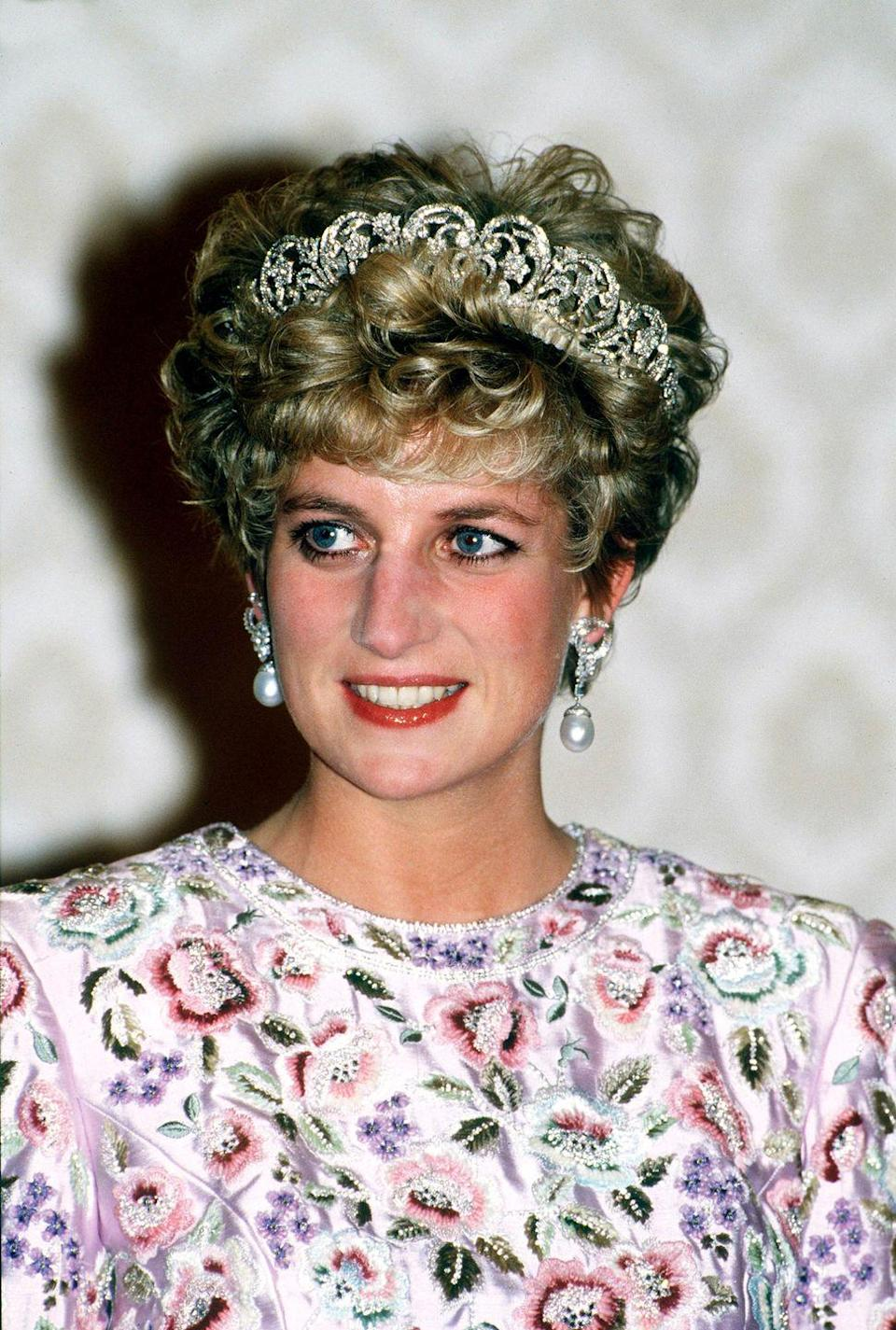 <p>For banquet thrown by President Roh in Seoul, South Korea, Princess Diana wore a colorful, embroidered Catherine Walker gown, paired with large pearl drop earrings and the Spencer tiara. </p>