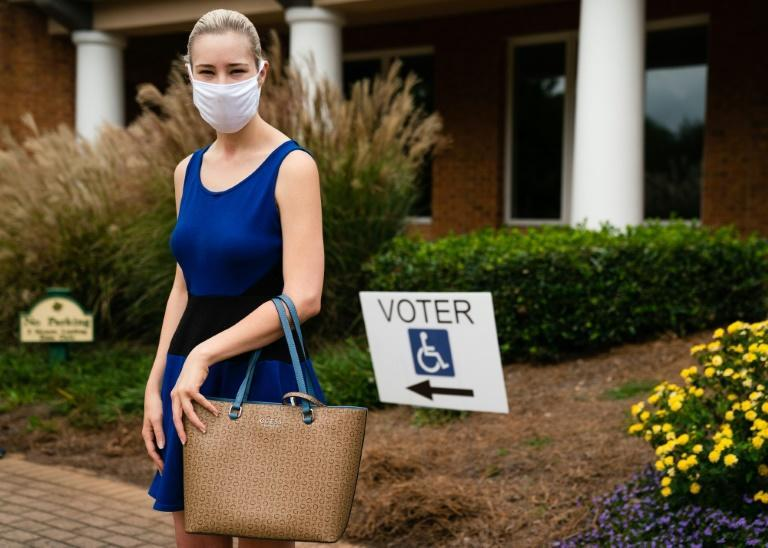 Ashley Dawson poses for a photo while waiting in line to cast her ballot in Smyrna, Georgia