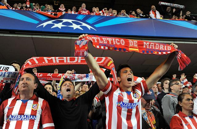 Atletico Madrid fans show their support in the stands during the Champions League semifinal second leg soccer match between Chelsea and Atletico Madrid at Stamford Bridge Stadium in London, Wednesday, April 30, 2014. (AP Photo/Andrew Matthews, PA Wire)