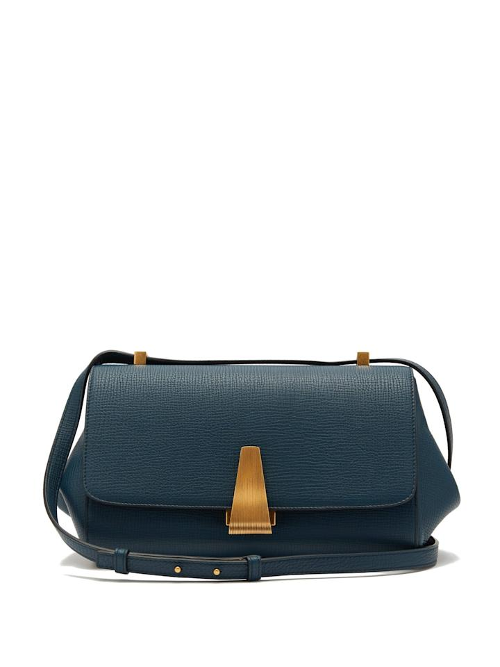 """<p>Recently, Daniel Lee's Bottega Veneta is having something of a cultural renaissance. The brand has always been a luxury staple, but the new designer is releasing pieces that perfectly walk the line between timeless and current. In a dream world, we'd like the entire collection, but this teal blue <a href=""""https://www.popsugar.com/buy/Bottega-Veneta-BV-Angle-Grained-leather-Shoulder-Bag-483872?p_name=Bottega%20Veneta%20BV%20Angle%20Grained-leather%20Shoulder%20Bag&retailer=matchesfashion.com&pid=483872&price=1%2C937&evar1=fab%3Aus&evar9=45692490&evar98=https%3A%2F%2Fwww.popsugar.com%2Fphoto-gallery%2F45692490%2Fimage%2F46536283%2FBottega-Veneta-BV-Angle-Grained-leather-Shoulder-Bag&list1=shopping%2Caccessories%2Cbags&prop13=api&pdata=1"""" rel=""""nofollow"""" data-shoppable-link=""""1"""" target=""""_blank"""" class=""""ga-track"""" data-ga-category=""""Related"""" data-ga-label=""""https://www.matchesfashion.com/us/products/Bottega-Veneta-BV-Angle-grained-leather-shoulder-bag-1306619"""" data-ga-action=""""In-Line Links"""">Bottega Veneta BV Angle Grained-leather Shoulder Bag</a> ($1,937) stands out.</p>"""