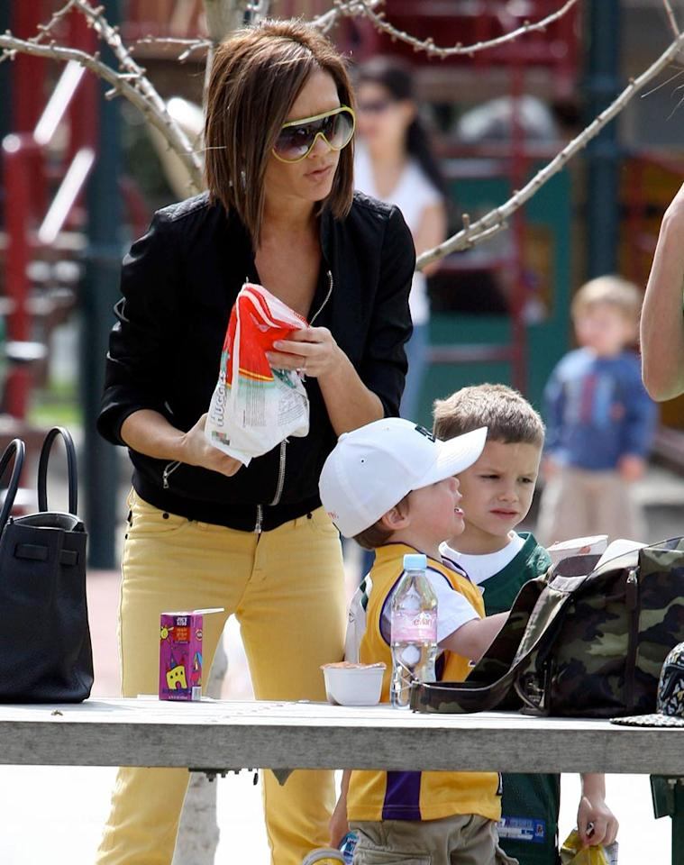 "Now that the Spice Girls Reunion Tour has wrapped, Victoria Beckham can spend more time with the family. Posh was spotted doting on sons Cruz and Romeo at a park on Thursday. Wonder if those juice boxes fit in her designer handbag? <a href=""http://www.x17online.com"" target=""new"">X17 Online</a> - March 6, 2008"