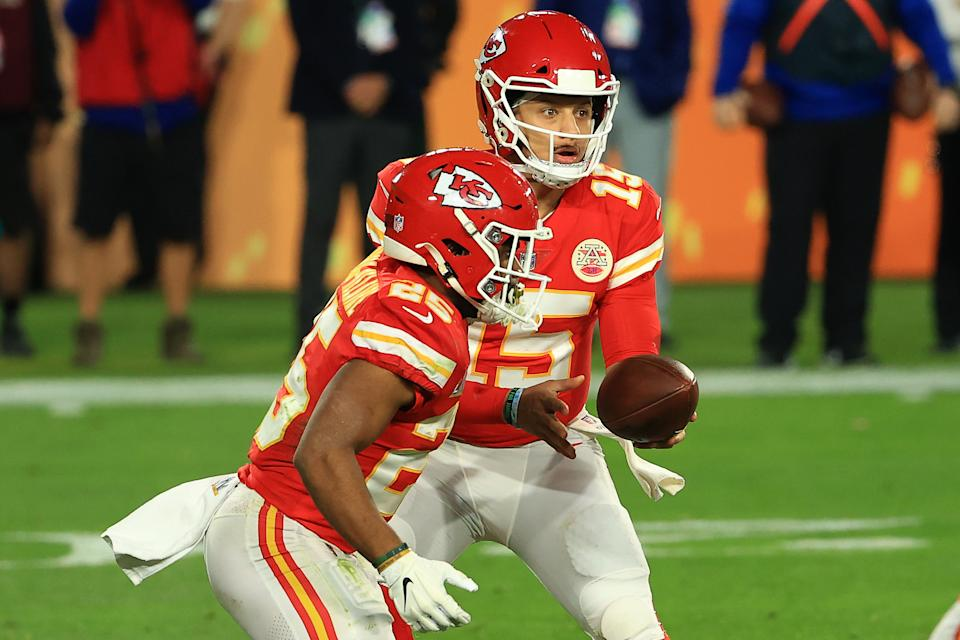 Patrick Mahomes #15 of the Kansas City Chiefs hands off to Clyde Edwards-Helaire #25