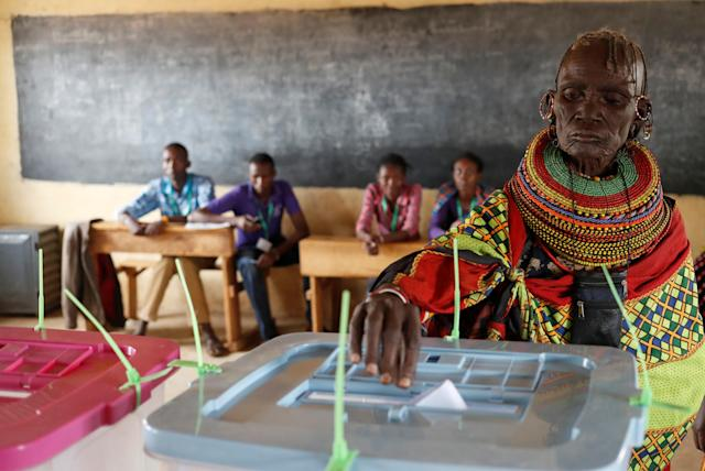 <p>A Turkana tribeswoman casts her ballot at a polling station during the election in a village near Baragoy, Kenya, Aug. 8, 2017. (Photo: /Goran Tomasevic/Reuters) </p>